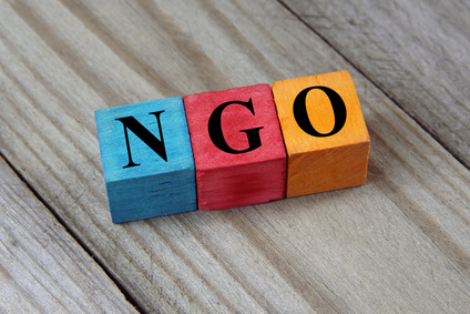 NGO (Non-Governmental Organization) sign on colorful wooden cube